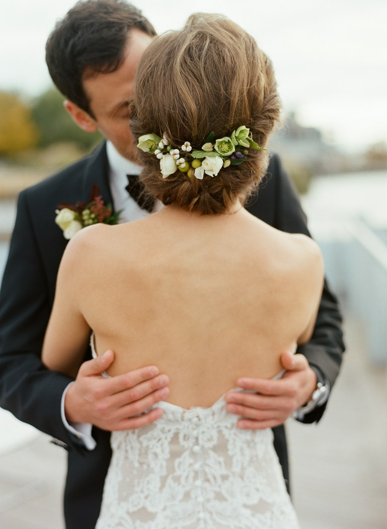 Brides With Most Recent Curly Wedding Updos With Flower Barrette Ties (View 7 of 20)