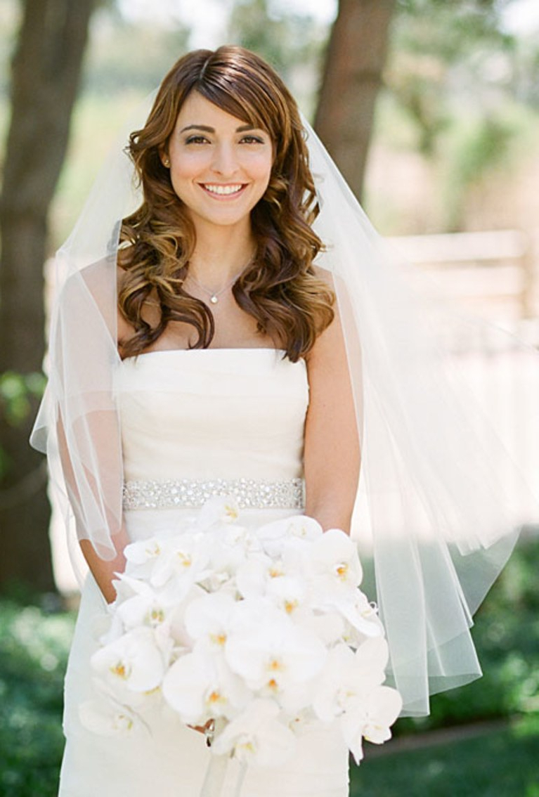 Brides Within Well Liked Curly Wedding Hairstyles With An Orchid (View 3 of 20)
