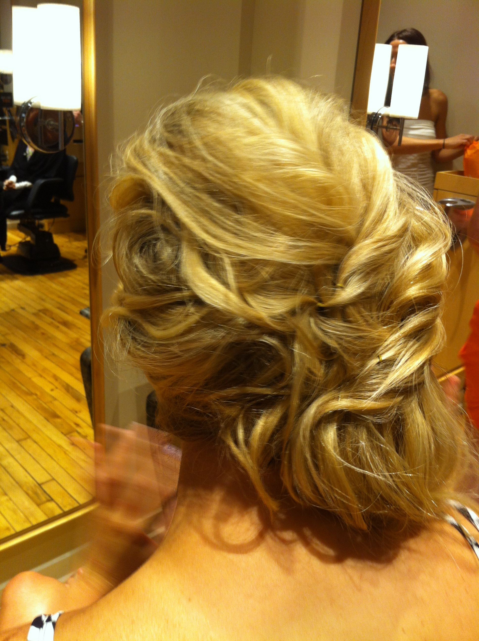 Cascading Curls With Twist To Side Half Up Hair Style (View 6 of 20)