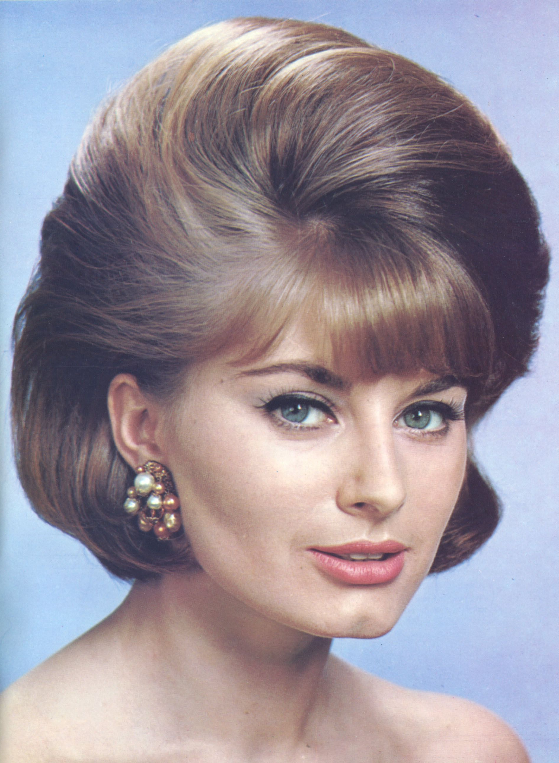 Current Curly Ash Blonde Updo Hairstyles With Bouffant And Bangs Within 50S Hair Goals #bouffanthairmodern (View 17 of 20)