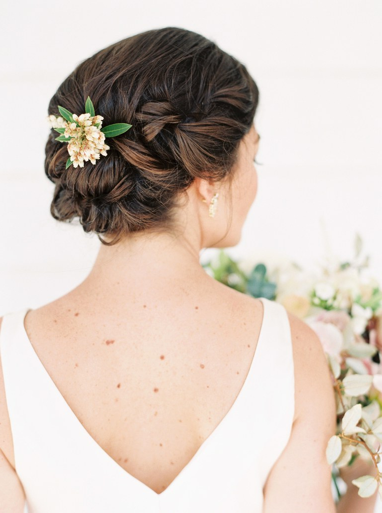 Current Curly Wedding Updos With Flower Barrette Ties With Regard To The 60 Prettiest Bridal Hairstyles From Real Weddings (View 17 of 20)