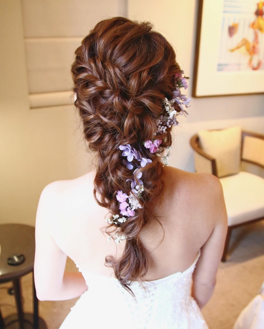 Different Shades Of Purple Blossoms In Her Hair — One Of The More Pertaining To Well Liked Braided Lavender Bridal Hairstyles (View 8 of 20)