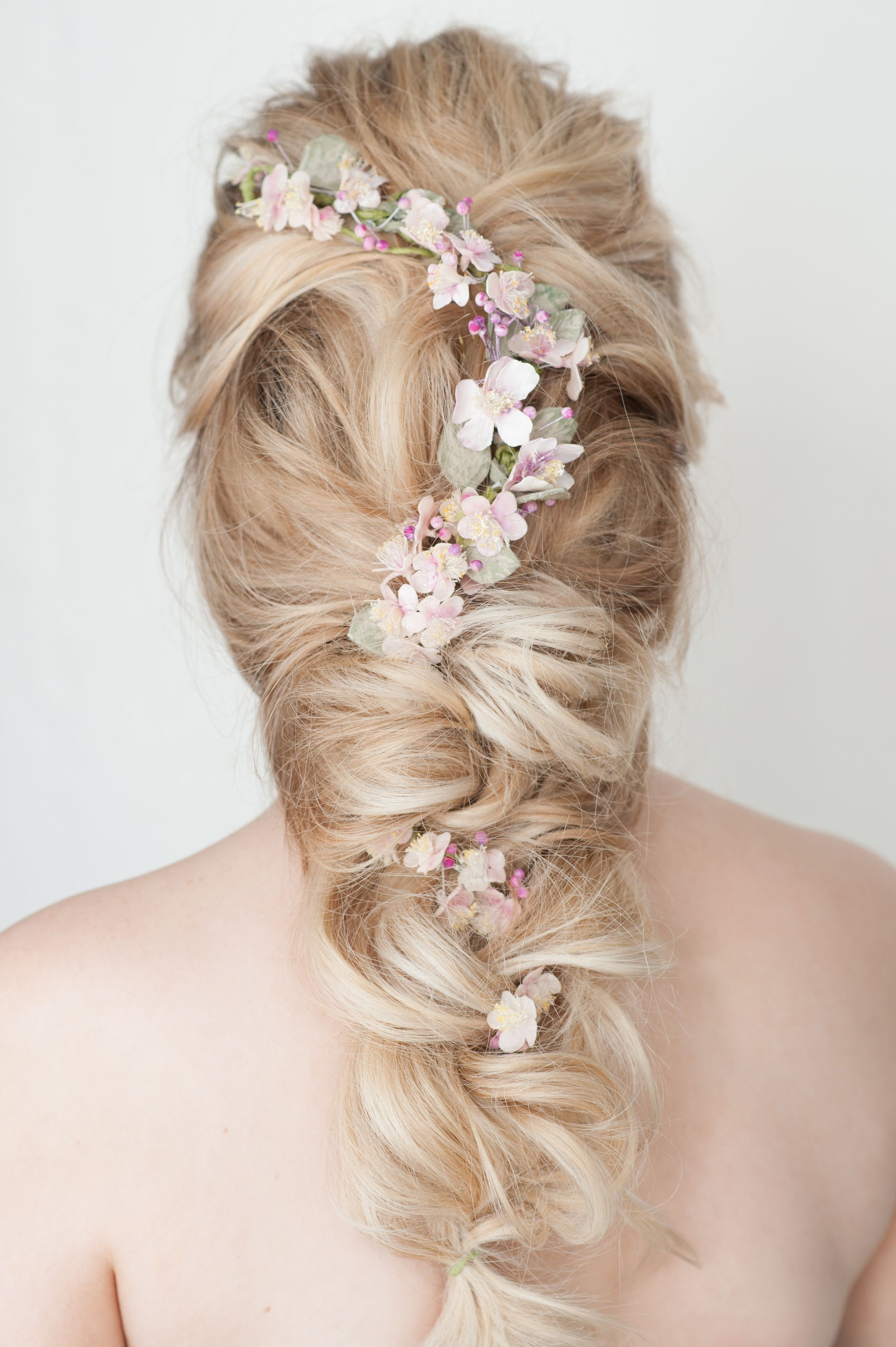 Fashionable Undone Low Bun Bridal Hairstyles With Floral Headband In Bridal Hair. Loose Undone Plait With Flowers. Www.facebook (Gallery 3 of 20)