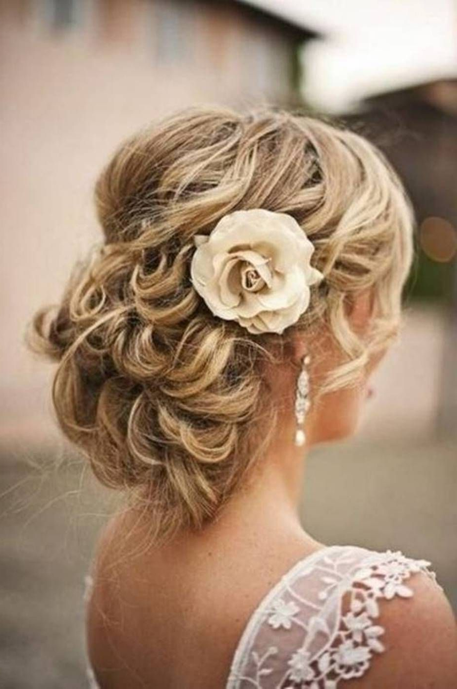 Hairstyle Names For Well Known Curly Wedding Updos With Flower Barrette Ties (View 3 of 20)
