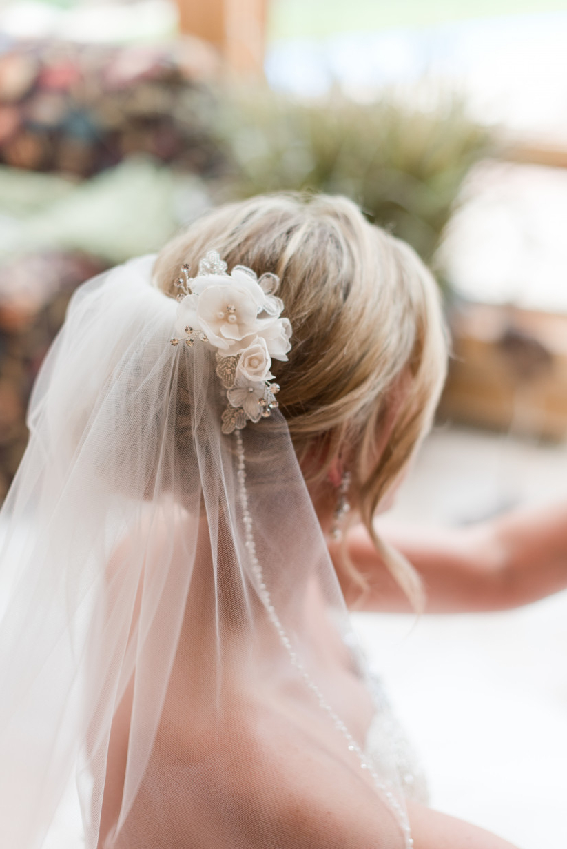 How To Wear A Veil With Every Wedding Hairstyle – Weddingwire Intended For Newest Curly Bridal Bun Hairstyles With Veil (Gallery 10 of 20)