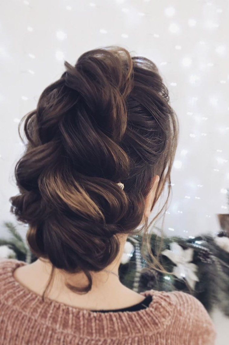 Latest Destructed Messy Curly Bun Hairstyles For Wedding Intended For Wedding Updos For Medium Length Hair,loose Braided Wedding Updos (View 10 of 20)