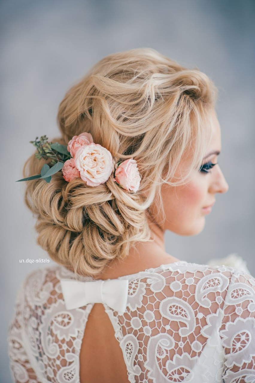Latest Wavy Low Bun Bridal Hairstyles With Hair Accessory Inside Wedding Hairstyles (View 11 of 20)