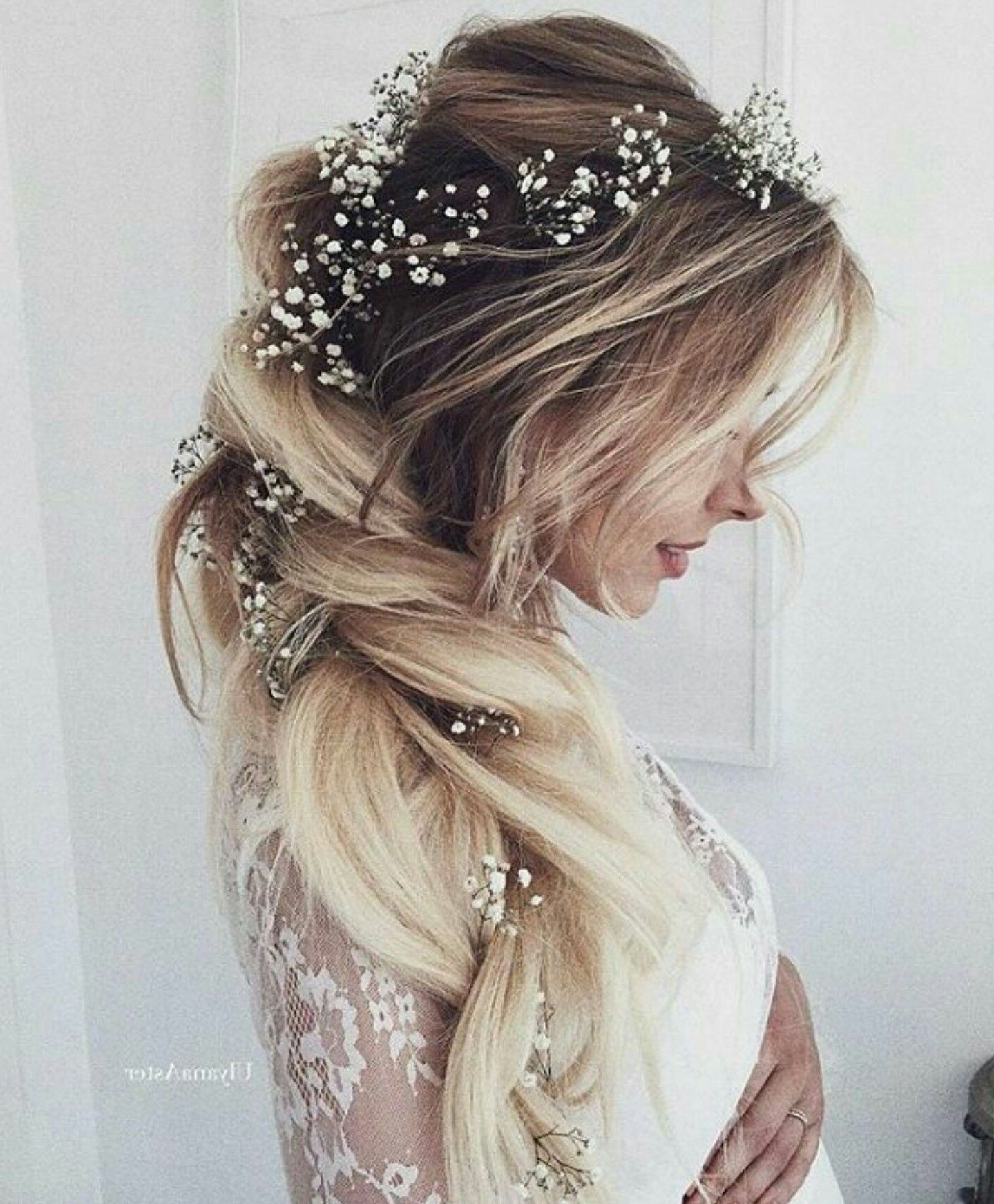 Most Recent White Blonde Twisted Hairdos For Wedding With Long Blond Bride Hair With Little White Flowers (View 4 of 20)