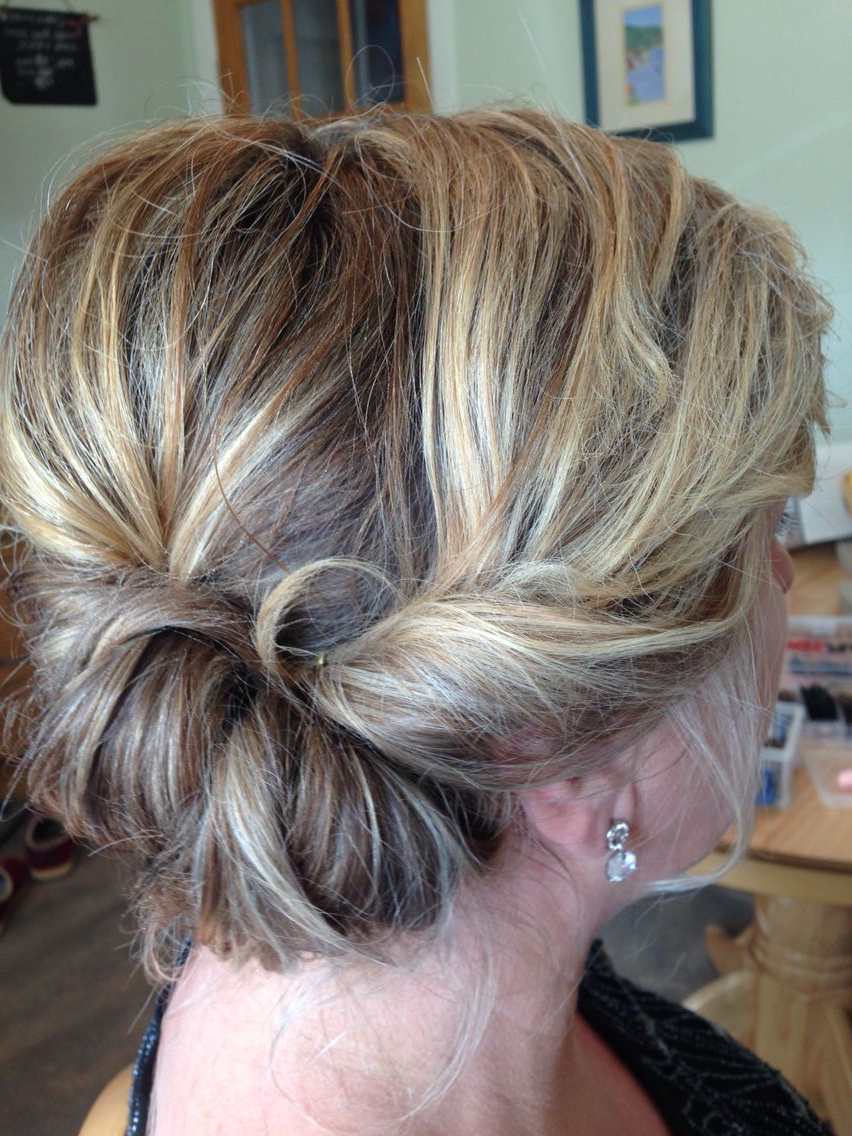 Newest Loose Updo Wedding Hairstyles With Whipped Curls With Regard To Roll To The Side Twist Mother Of The Bride Loose Updo (View 17 of 20)