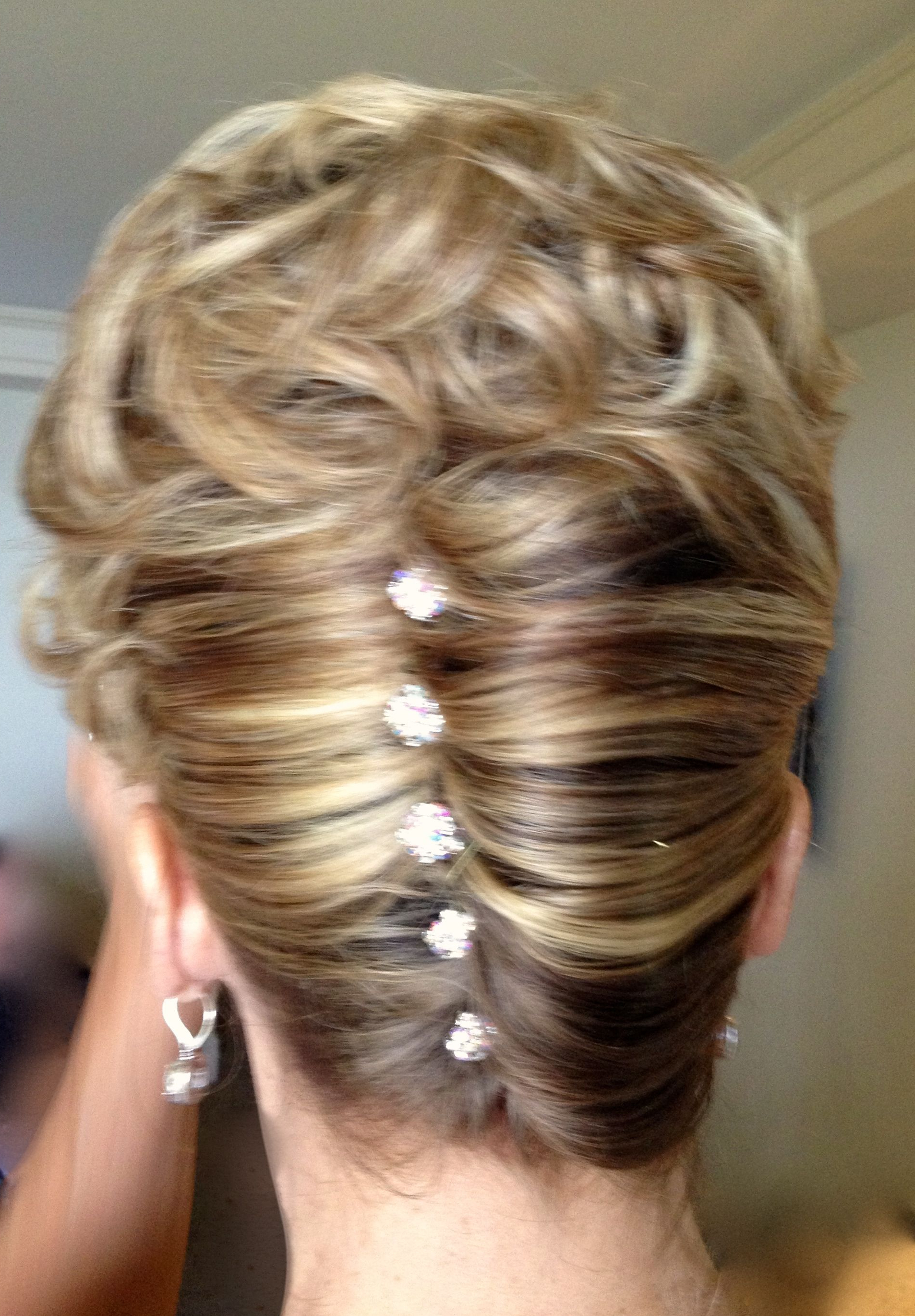 Popular Classic Twists And Waves Bridal Hairstyles Intended For Mother Of The Bride Classic French Twist With A Little Sparkle (View 14 of 20)