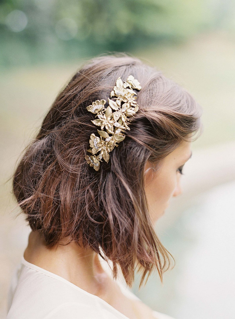 Popular Curly Wedding Updos With Flower Barrette Ties Within 20 Wedding Hairstyles For Short Hair: Updos, Half Up & More (View 4 of 20)