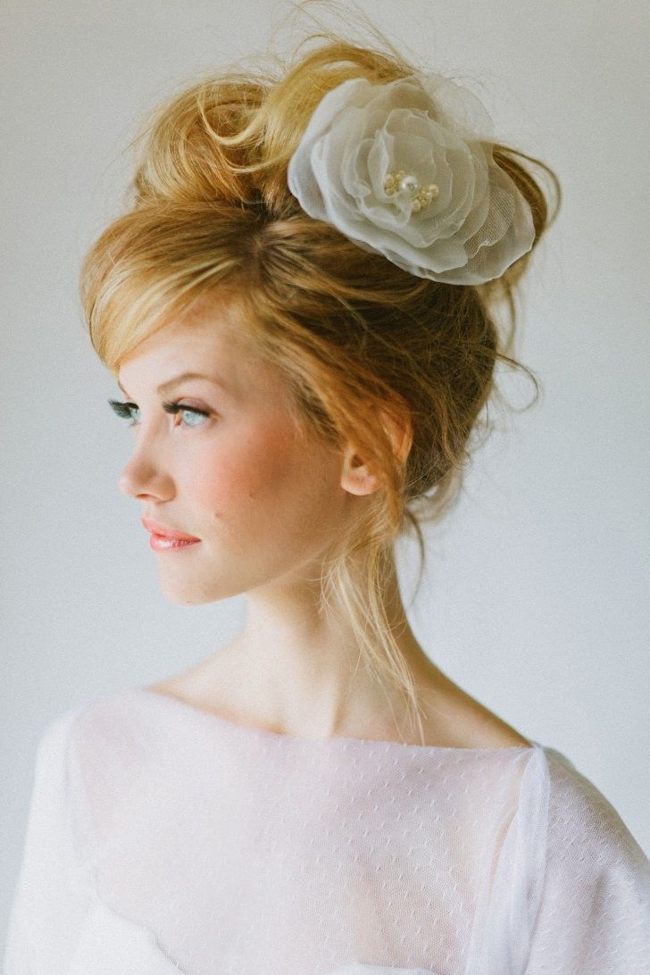 Preferred Bold Blonde Bun Bridal Updos Regarding Wedding Hair Updos With Fascinator, Wedding Hair Updos For Fine Hair (View 2 of 20)