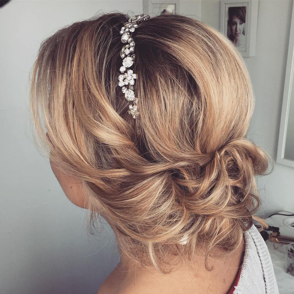 Preferred Embellished Caramel Blonde Chignon Bridal Hairstyles Inside Top 20 Wedding Hairstyles For Medium Hair (View 14 of 20)