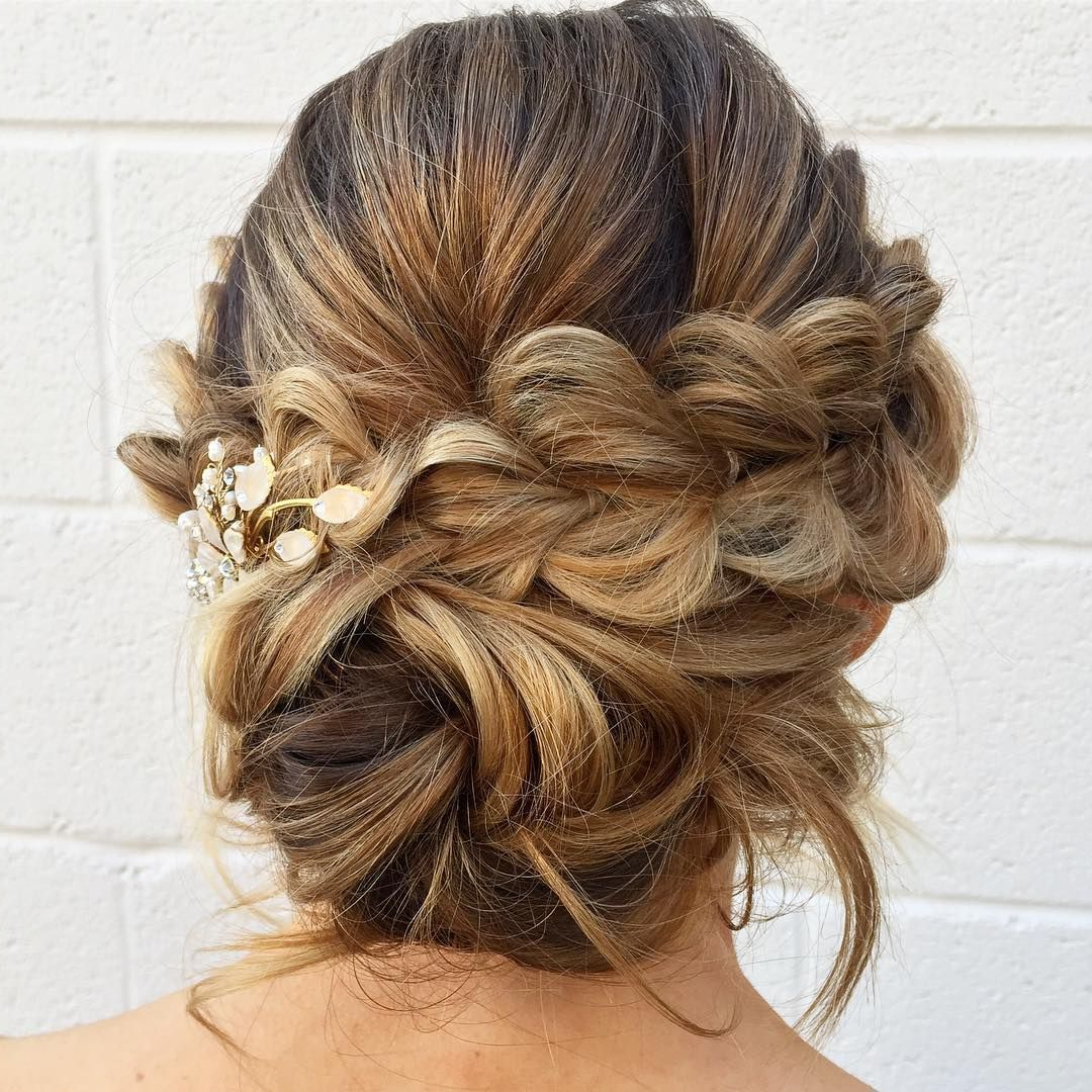 Pull Through Braid With A Low Messy Bun In The Back,updo Hairstyles Regarding Recent Messy Woven Updo Hairstyles For Mother Of The Bride (View 16 of 20)