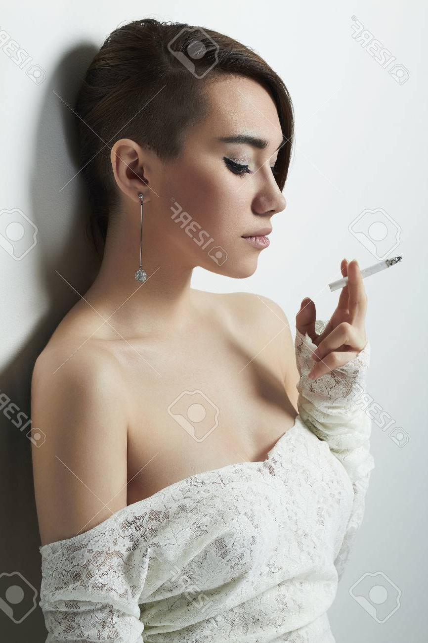 Recent Short And Sweet Hairstyles For Wedding Within Beautiful Young Woman With Short Haircut Smoking Cigarette.hairstyle (Gallery 12 of 20)