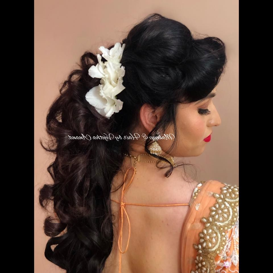 Featured Photo of Curly Wedding Hairstyles With An Orchid