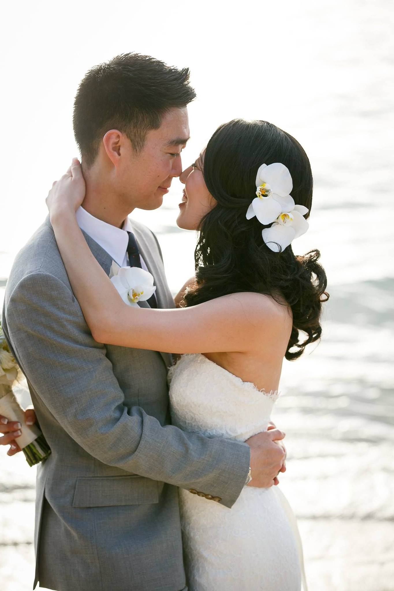 Side Pony Asian Hair Orchids Beach Wedding Hawaii Whik'd Hair And Inside Popular Curly Wedding Hairstyles With An Orchid (View 14 of 20)