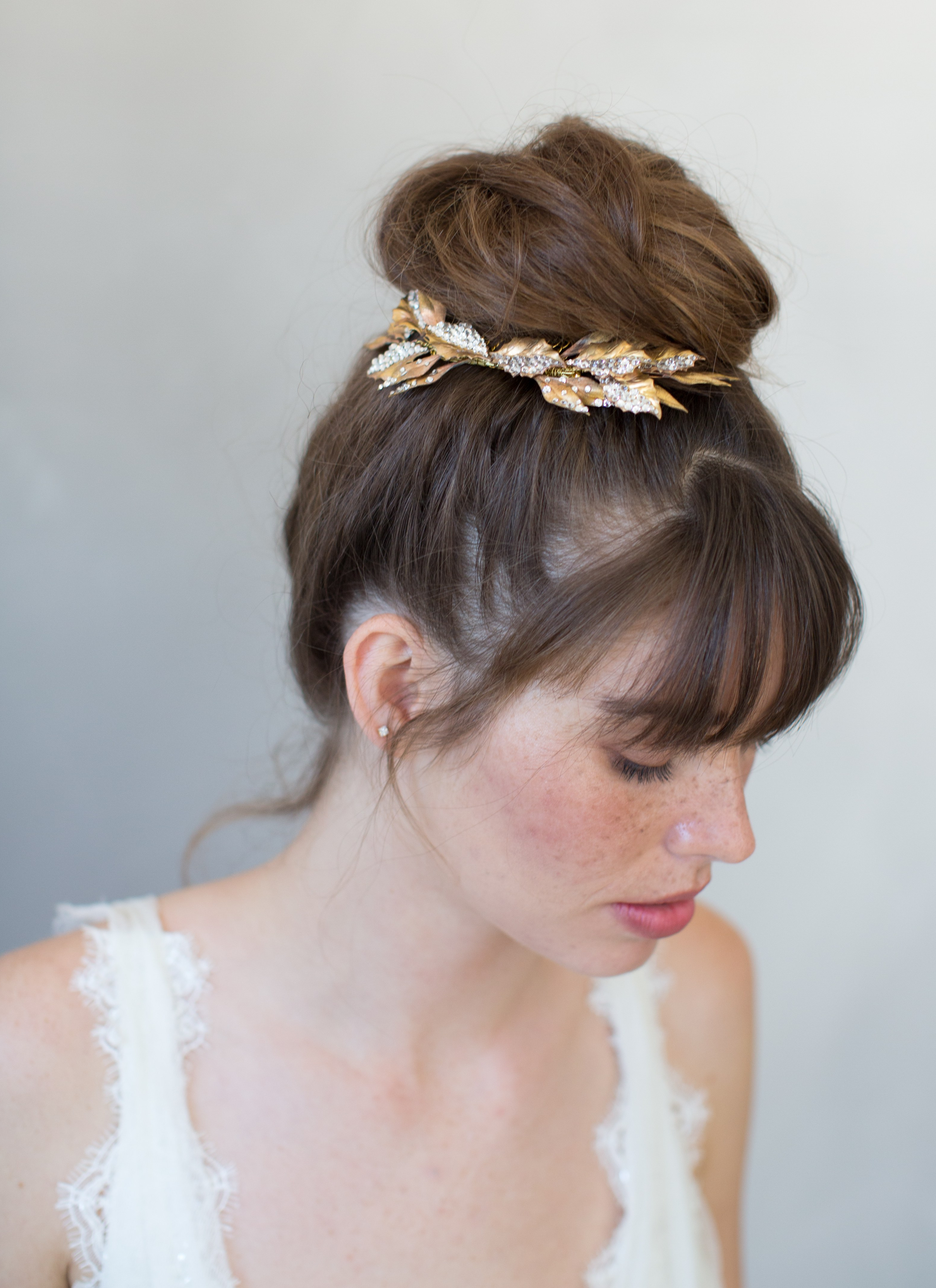 These Enchanting Hair Accessories Are Perfect For A Rustic Wedding For Most Popular Undone Low Bun Bridal Hairstyles With Floral Headband (View 15 of 20)