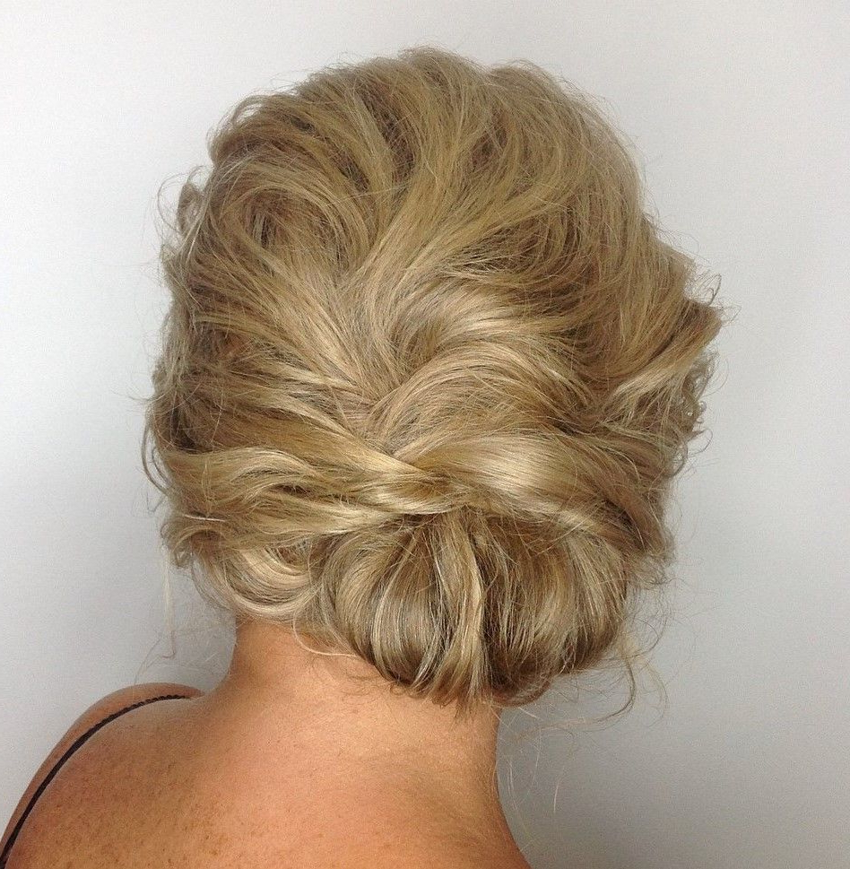 Featured Photo of Tousled Asymmetrical Updo Wedding Hairstyles