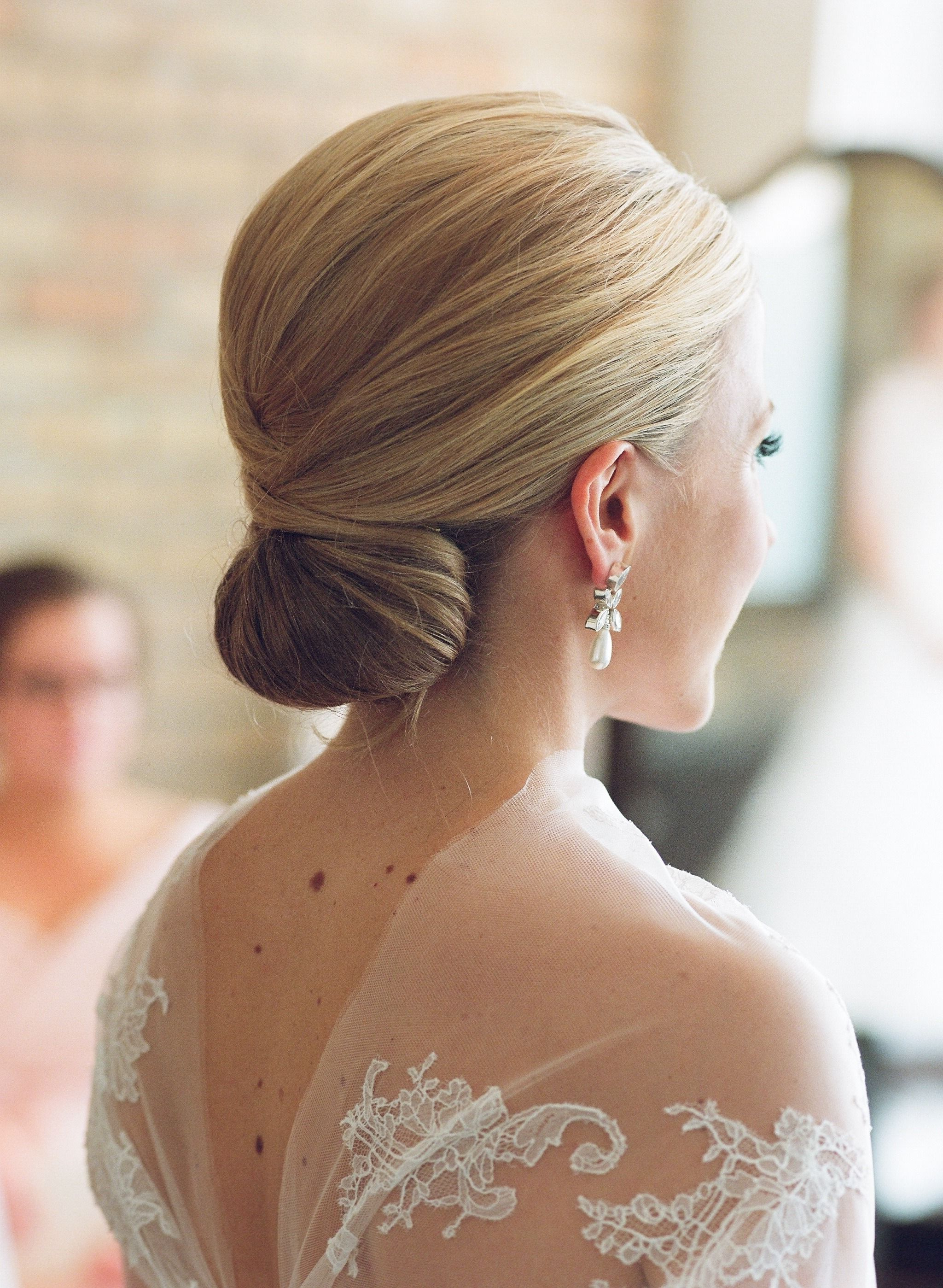 Featured Photo of Sleek Low Bun Rosy Outlook Wedding Updos