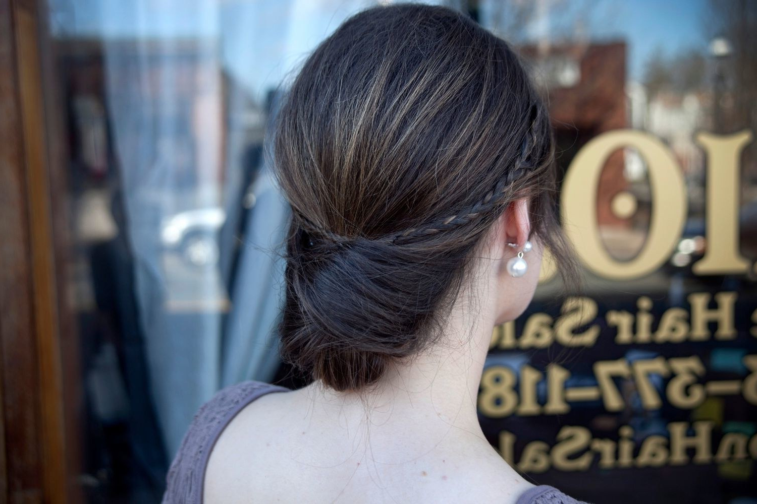 Wedding Hairstyles Diy: Low Bun With Accent Braid How To – Glamour Pertaining To Recent Criss Cross Wedding Hairstyles (View 11 of 20)