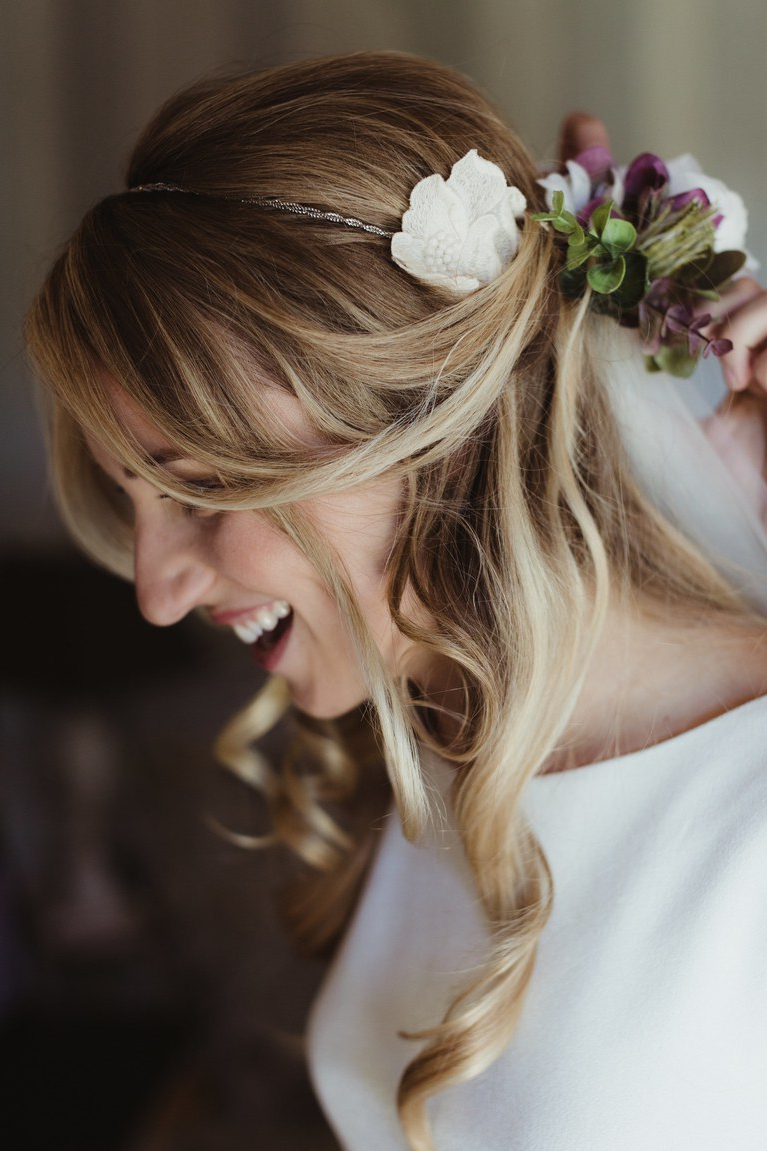 Well Known Undone Low Bun Bridal Hairstyles With Floral Headband In 51 Romantic Wedding Hairstyles (View 18 of 20)