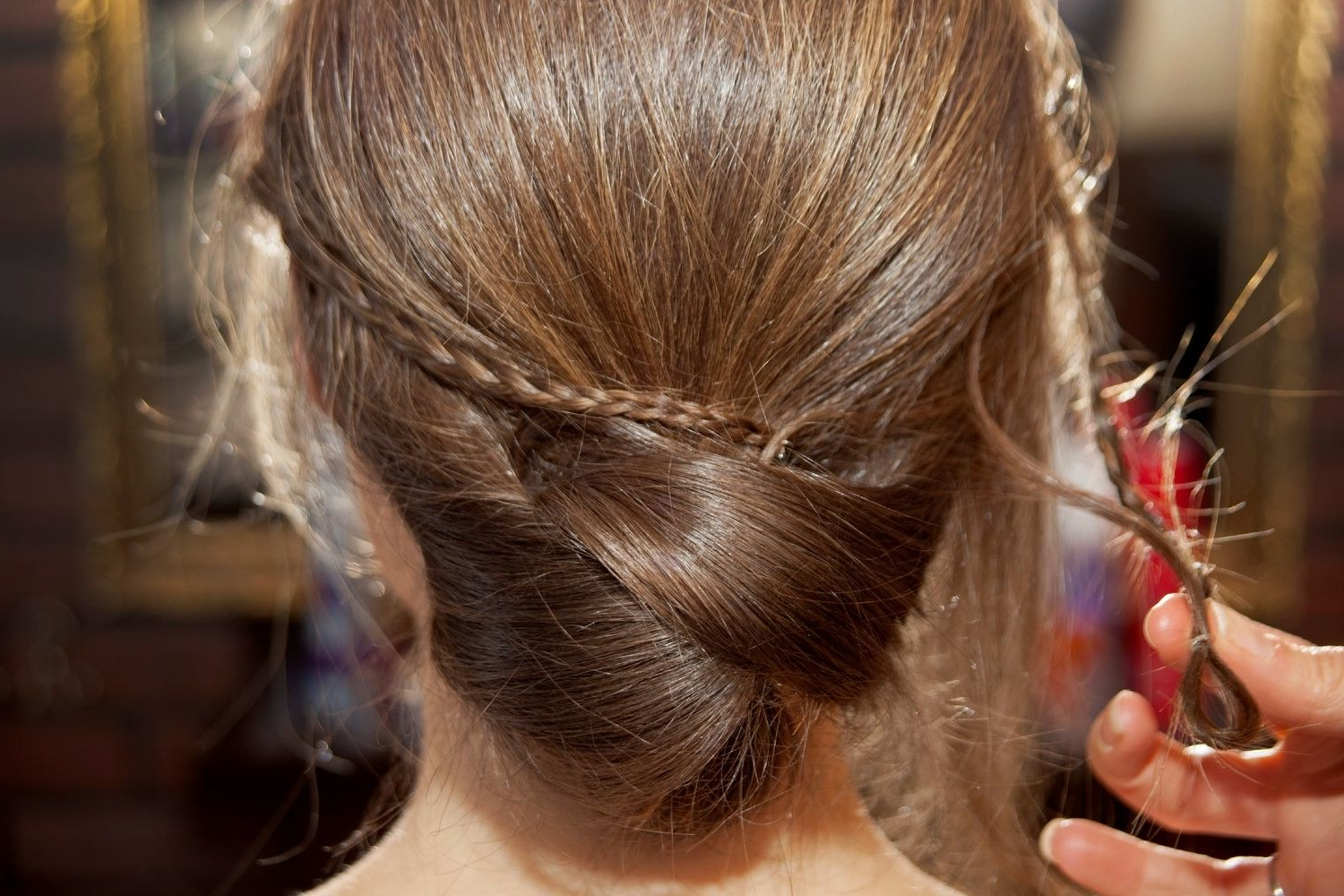 Well Liked Criss Cross Wedding Hairstyles Throughout Wedding Hairstyles Diy: Low Bun With Accent Braid How To – Glamour (View 4 of 20)