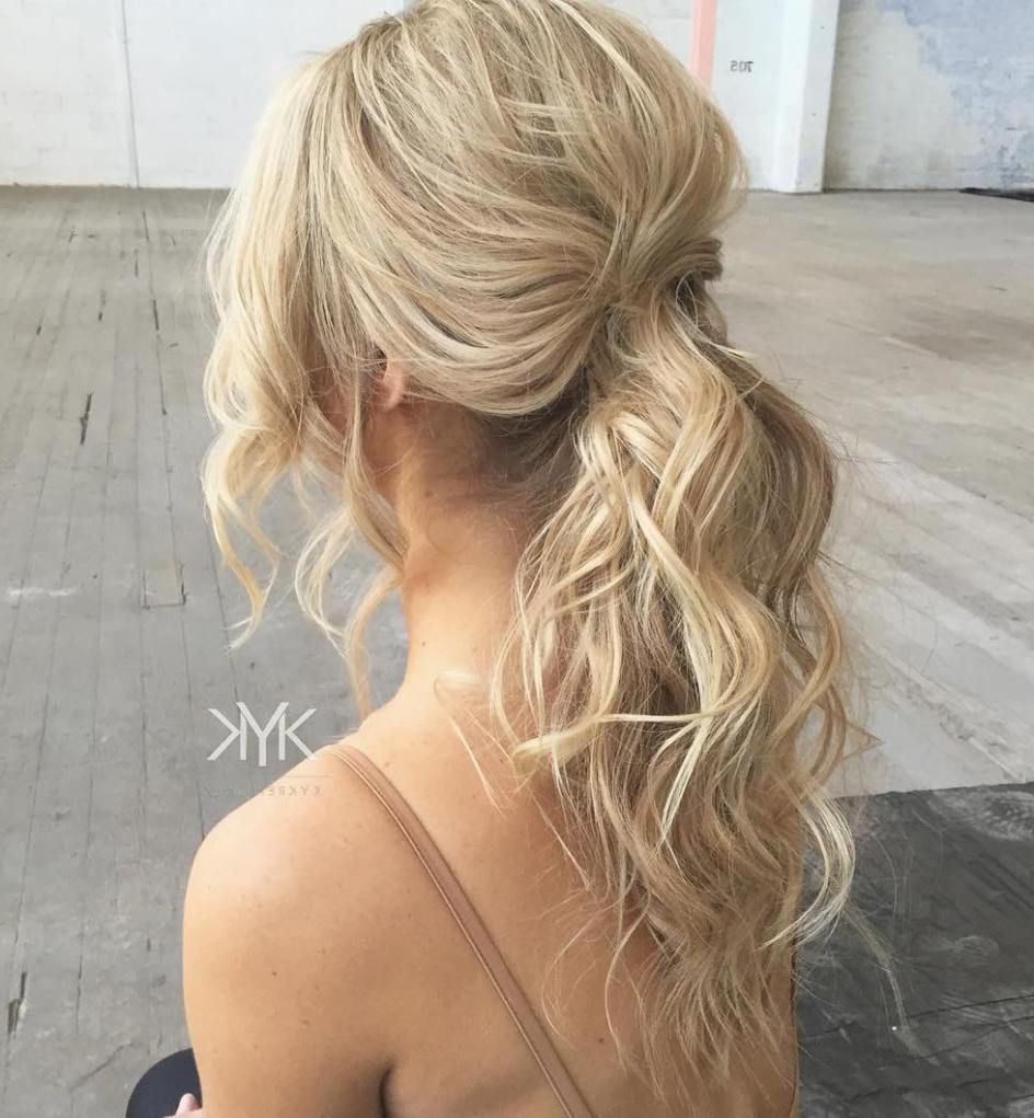 Well Liked Wavy And Wispy Blonde Updo Wedding Hairstyles Inside 30 Eye Catching Ways To Style Curly And Wavy Ponytails (View 18 of 20)