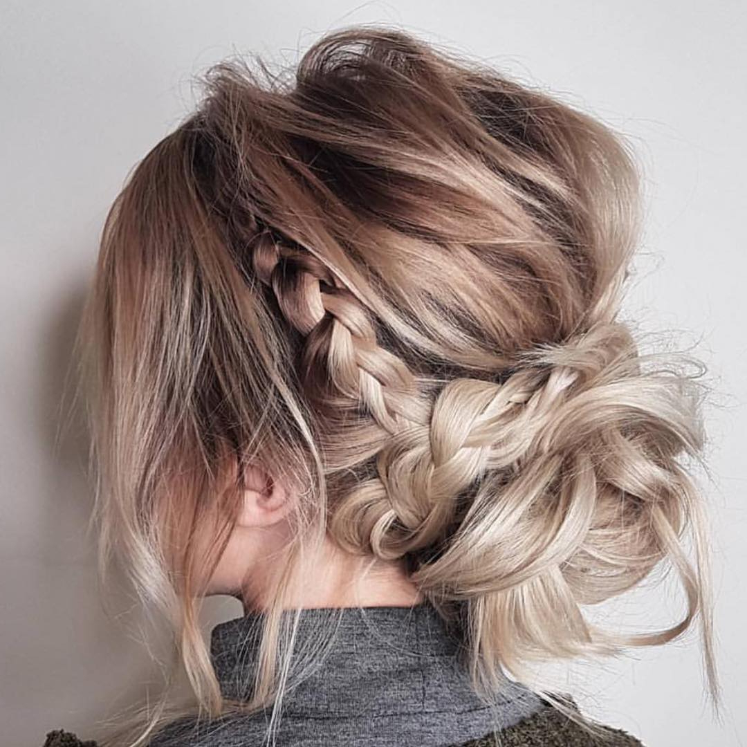 10 Updos For Medium Length Hair From Top Salon Stylists Within 2018 Diagonal Braid And Loose Bun Hairstyles For Prom (View 2 of 20)