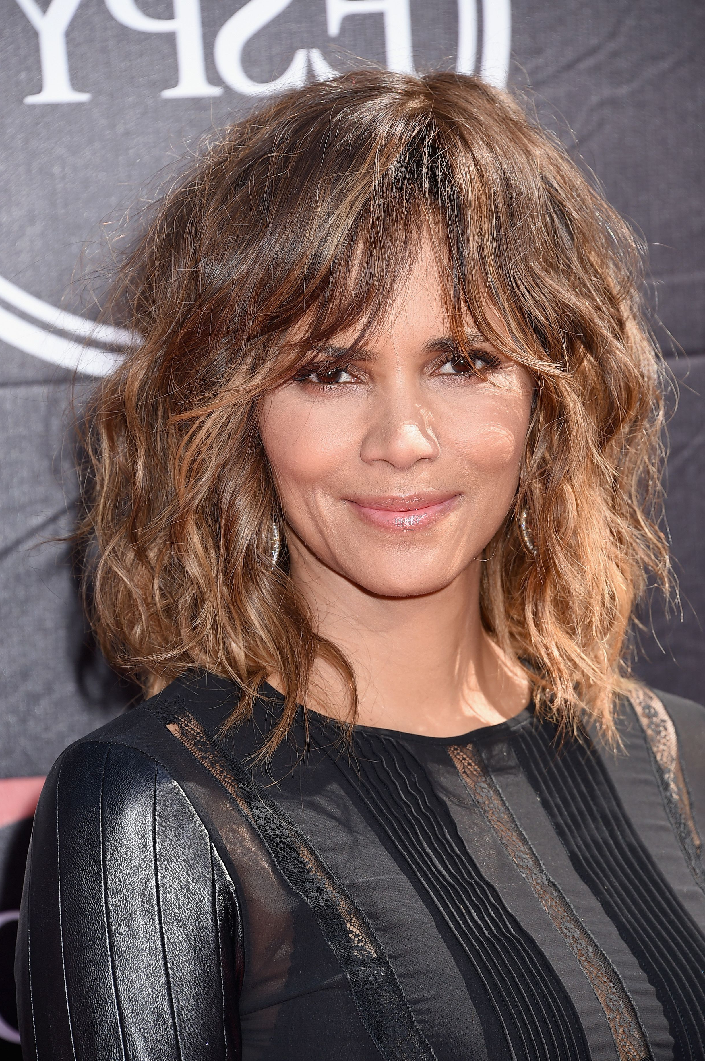 35 Best Hairstyles With Bangs – Photos Of Celebrity Haircuts With Bangs For Most Popular Messy Loose Curls Long Hairstyles With Voluminous Bangs (View 13 of 20)