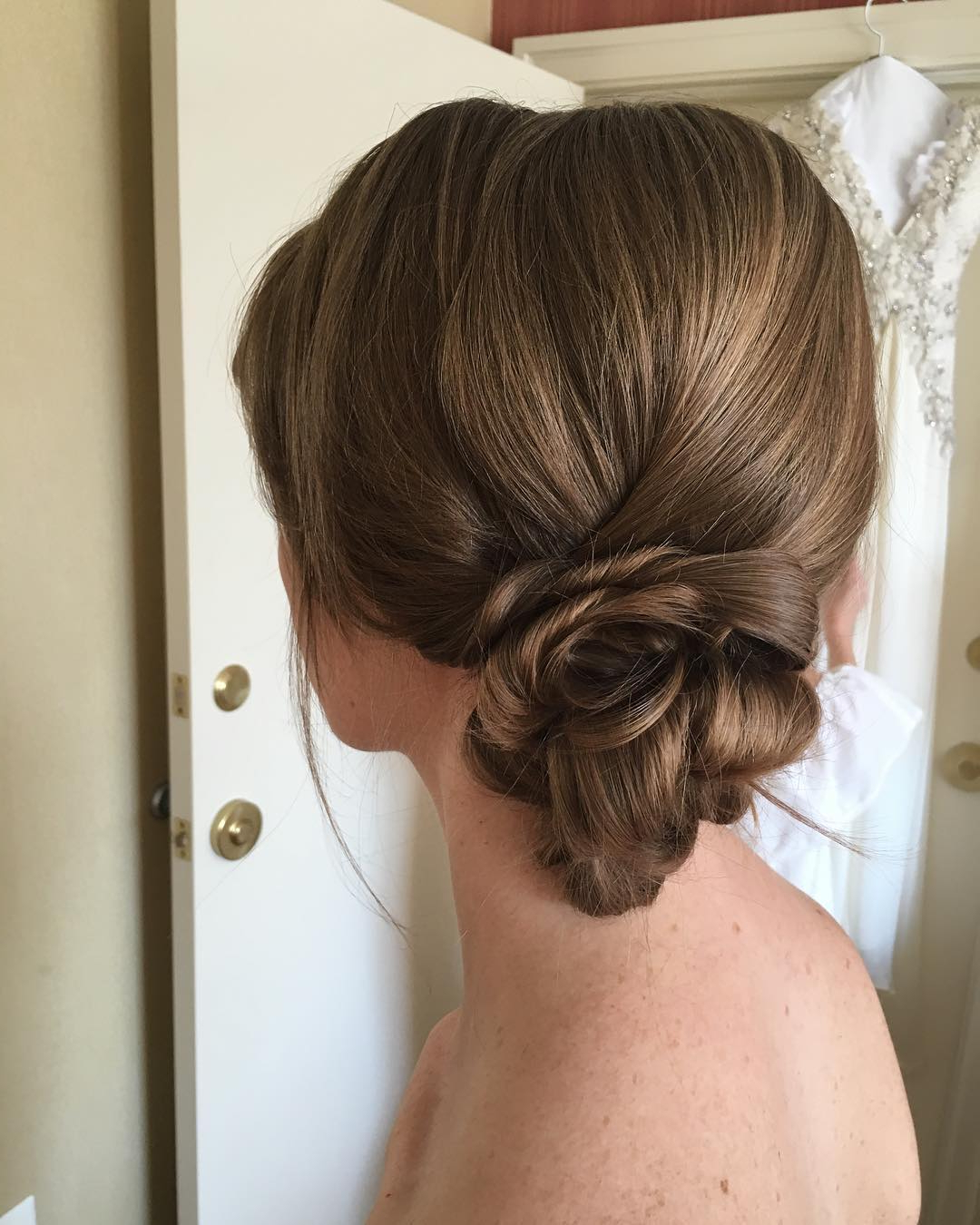 38 Flower Shaped Hairstyles For Special Occasions Throughout Most Recently Released Looped Low Bun Hairstyles (View 11 of 20)