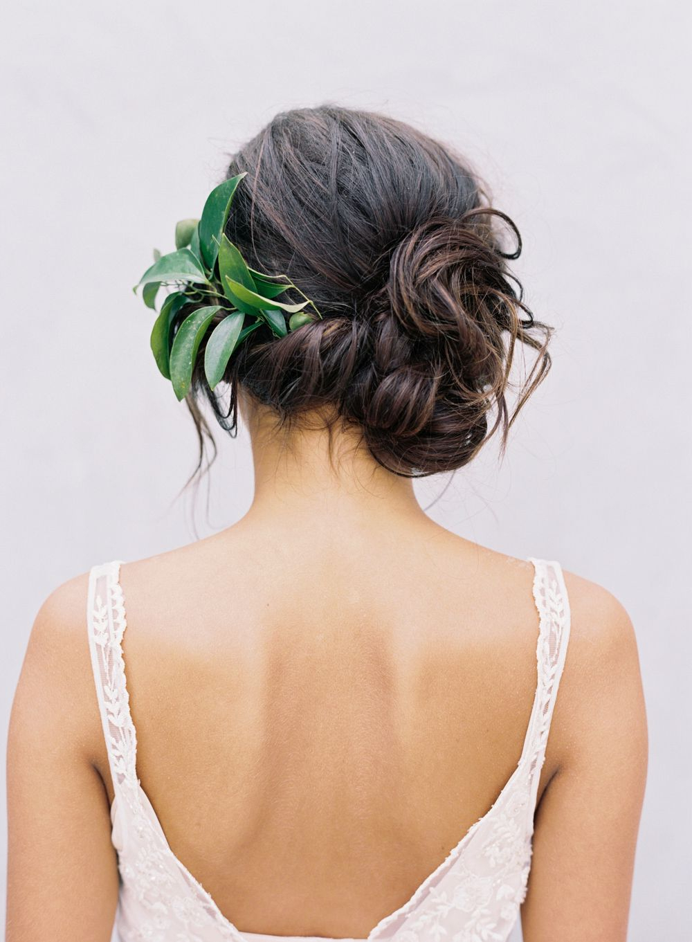 A Classic Wedding Updo, Loose Side Bun, Romantic Side Swept Updo Inside Favorite Side Bun Prom Hairstyles With Black Feathers (View 5 of 20)
