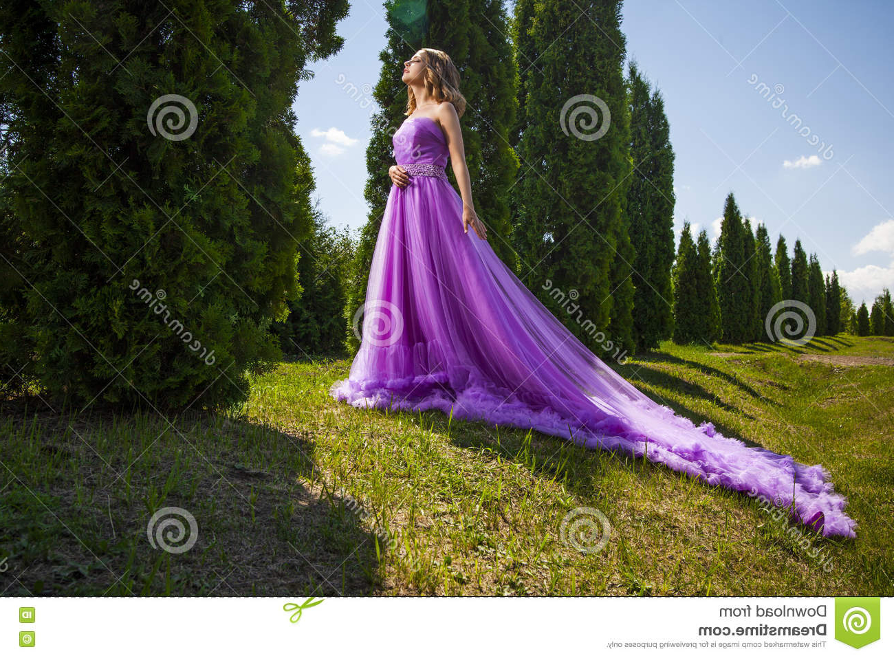 Beautiful Woman In Long Pink Dress Like Princess In Green Garden With Regard To Widely Used Princess Like Side Prom Downdos (View 6 of 20)