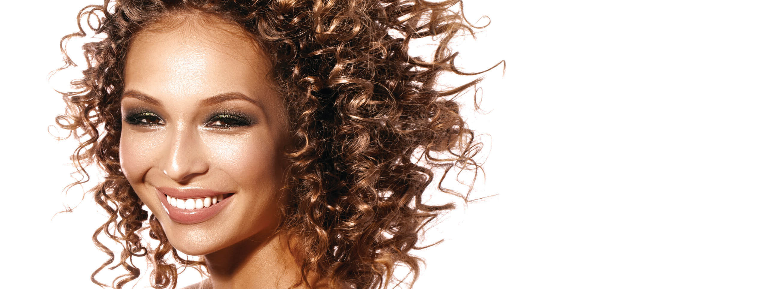 Best And Newest Winding Waves Hairstyles Throughout Using A Curling Iron To Create Curls (View 9 of 20)