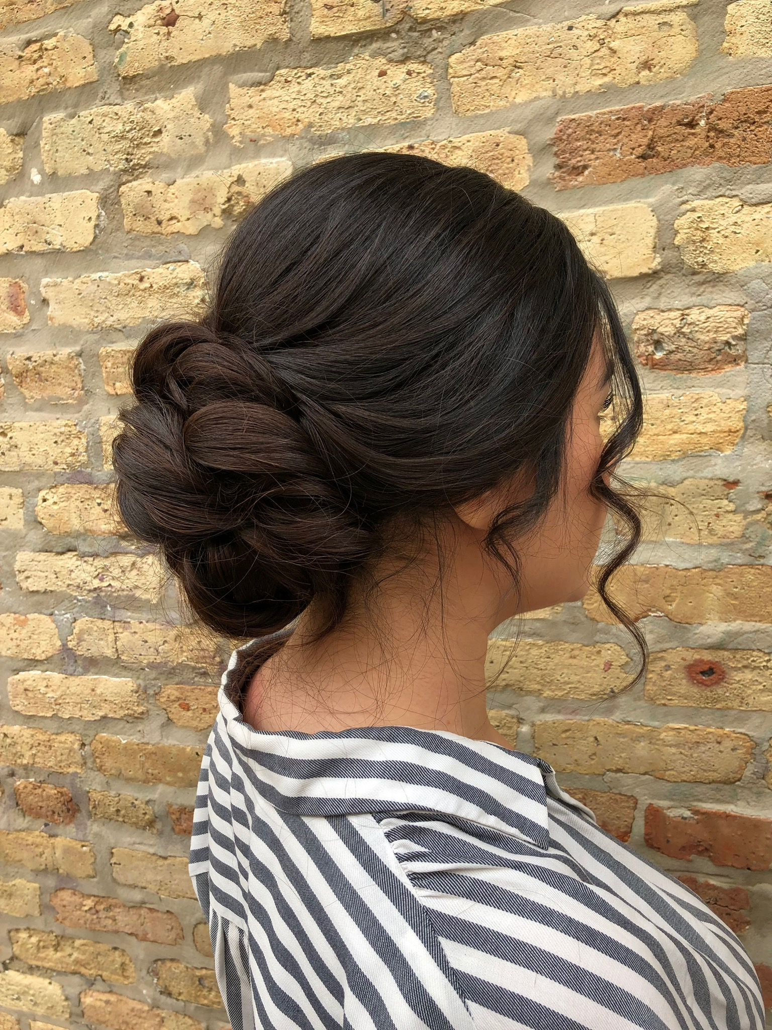 Elegant Swept Back Updo With Low Bun + Curly Face Framing Pieces In Best And Newest Low Pearled Prom Updos (View 7 of 20)