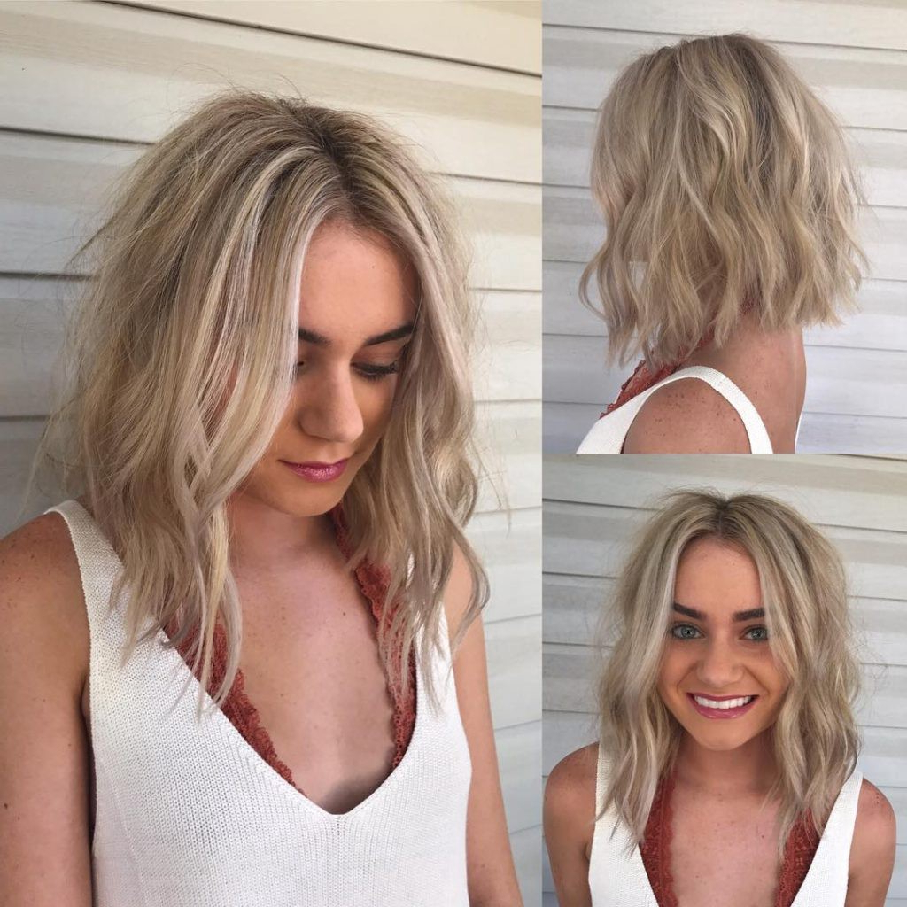 Favorite Blonde Textured Haircuts With Angled Layers Within Long Light Blonde Angled Bob With Wavy Beach Textured Layers And (Gallery 14 of 20)