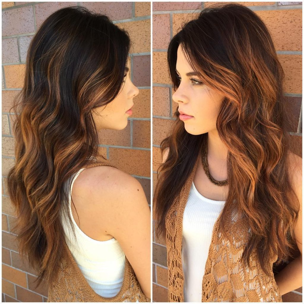 Favorite Long Tousled Voluminous Hairstyles With Regard To Women's Brunette Layered Cut With Tousled Waves And Warm Caramel (View 7 of 20)
