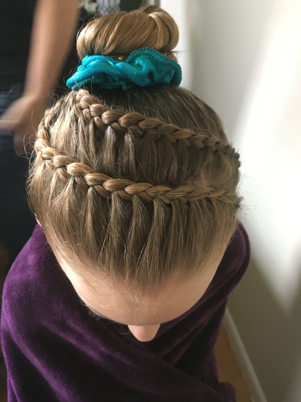 Favorite Side Bun Twined Prom Hairstyles With A Braid Pertaining To Hairstyles For Long Hair Gymnastics (View 10 of 20)