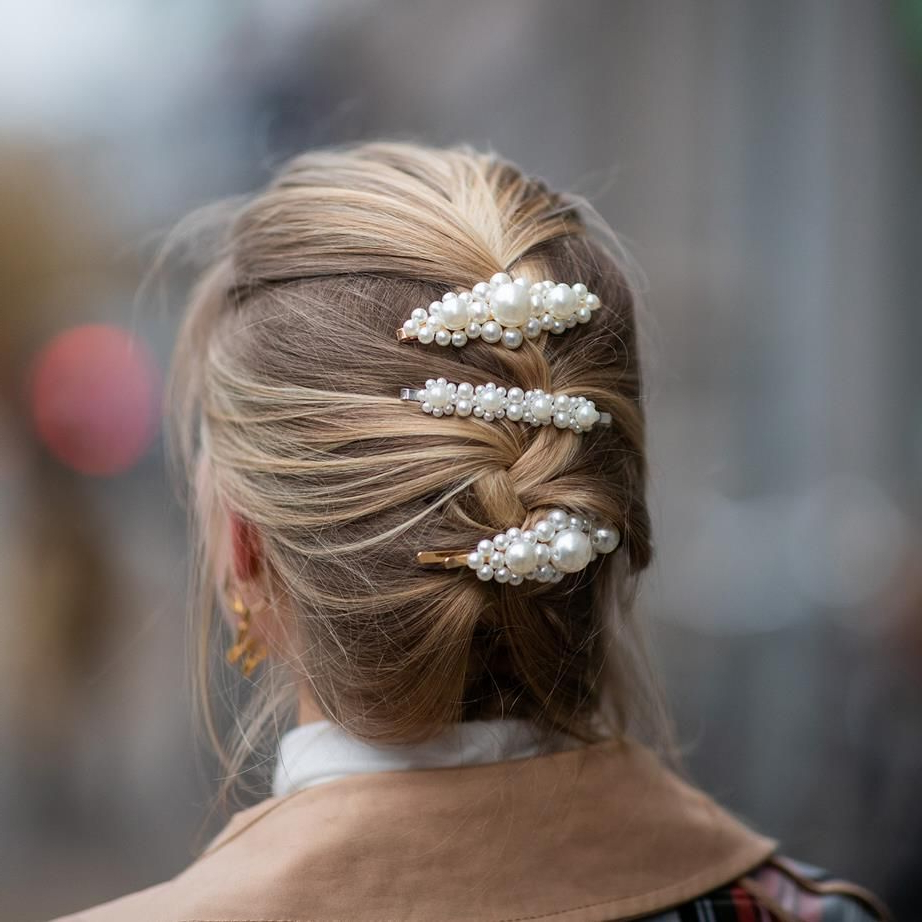 Hair Within Most Popular Side Bun Prom Hairstyles With Jewelled Barrettes (View 12 of 20)