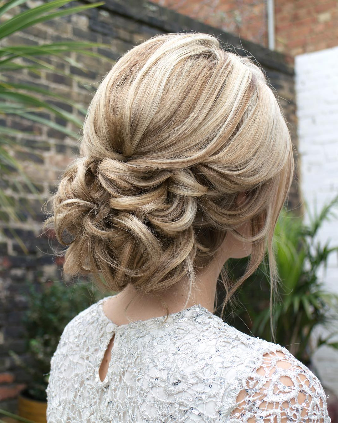 20 Ideas of Volumized Low Chignon Prom Hairstyles