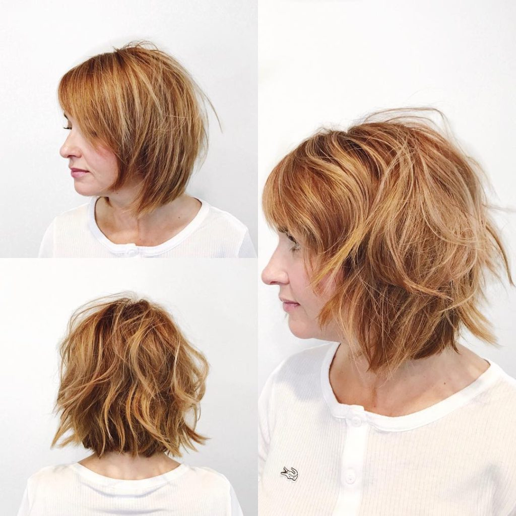 Well Known Light Layers Hairstyles Enhanced By Color Regarding Women's Undone Razor Cut Bob With Side Swept Bangs And Light Auburn (Gallery 19 of 20)