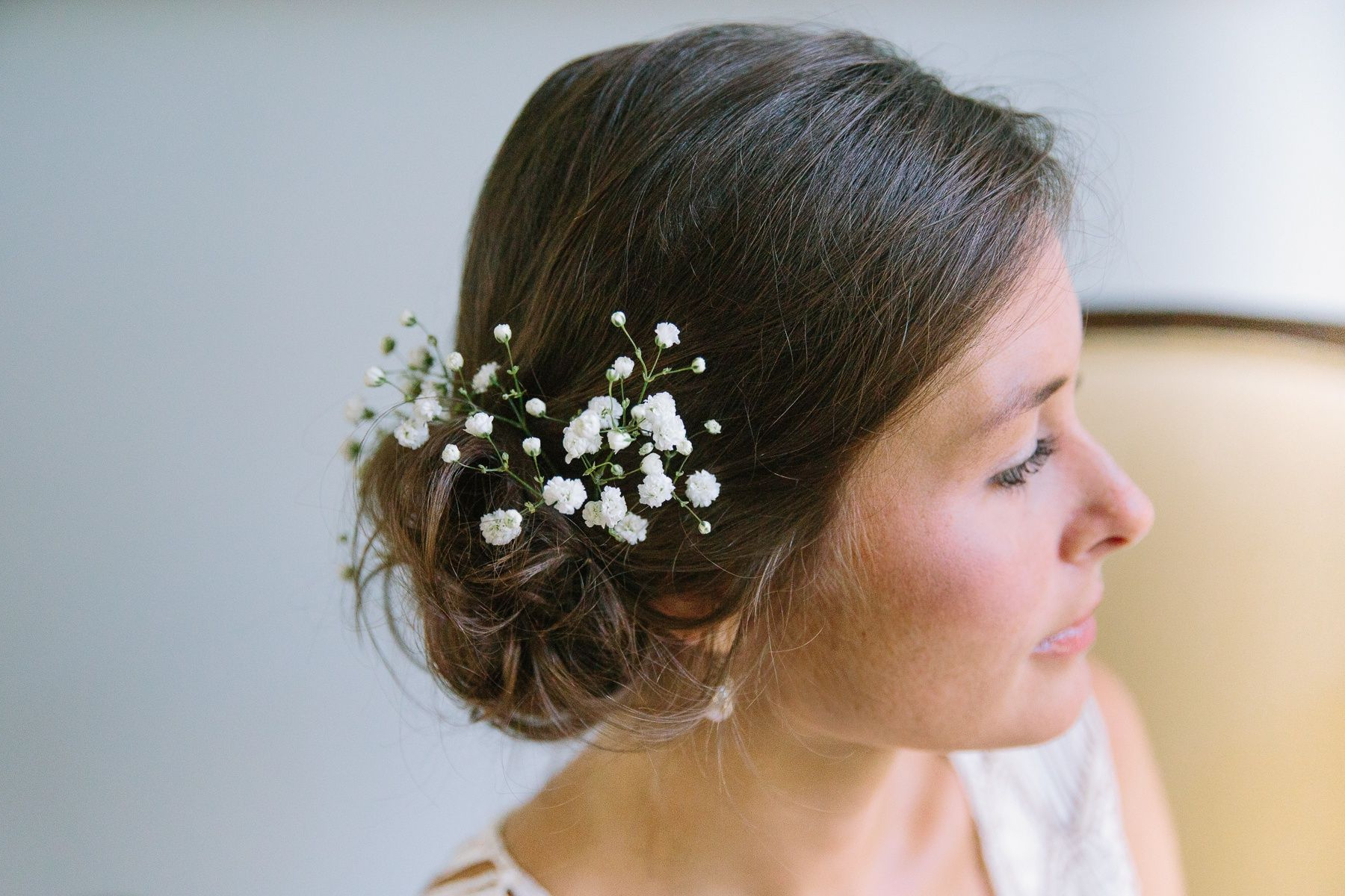 Widely Used Side Bun Prom Hairstyles With Jewelled Barrettes Pertaining To Bridal Hair Inspiration – Loose Side Bun With Babys Breath. Beach (Gallery 20 of 20)