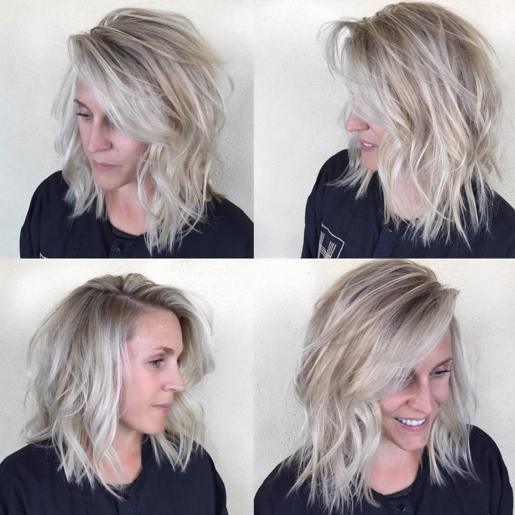 Women's Undone Textured Lob With Long Side Swept Bangs And Pale For Popular Blonde Textured Haircuts With Angled Layers (View 20 of 20)