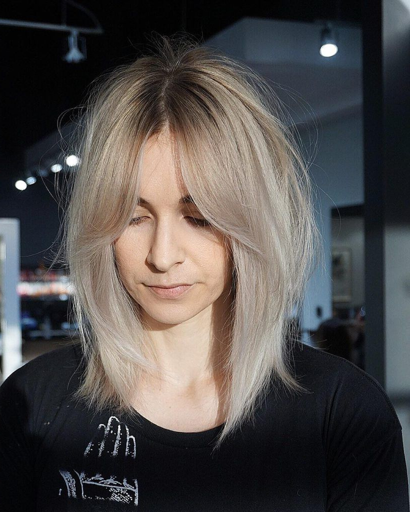 2019 Shaggy Bob Hairstyles With Curtain Bangs Throughout Shaggy Curtain Banged Lob With Undone Straight Texture And Platinum (View 4 of 20)