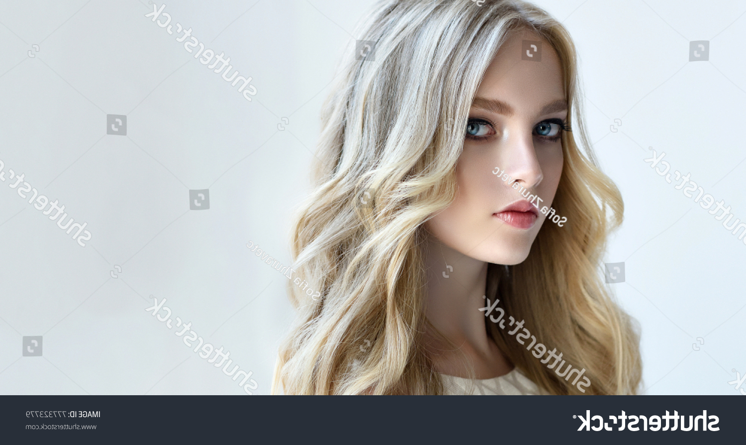 Стоковая Фотография «Blonde Fashion Girl Long Shiny Curly» (Изменить Pertaining To Most Up To Date Shiny Tousled Curls Hairstyles (View 20 of 20)