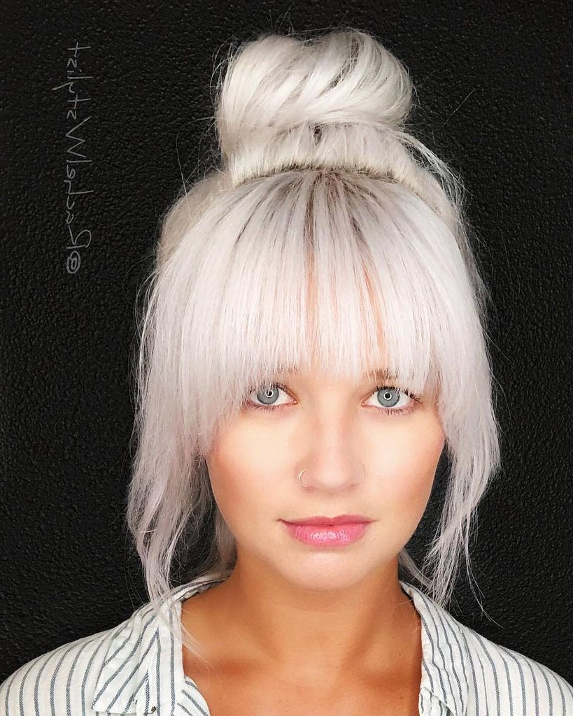 Large Messy Top Bun With Full Face Framing Fringe And Platinum With Most Up To Date Big Hair And Full Bangs Hairstyles (View 10 of 20)