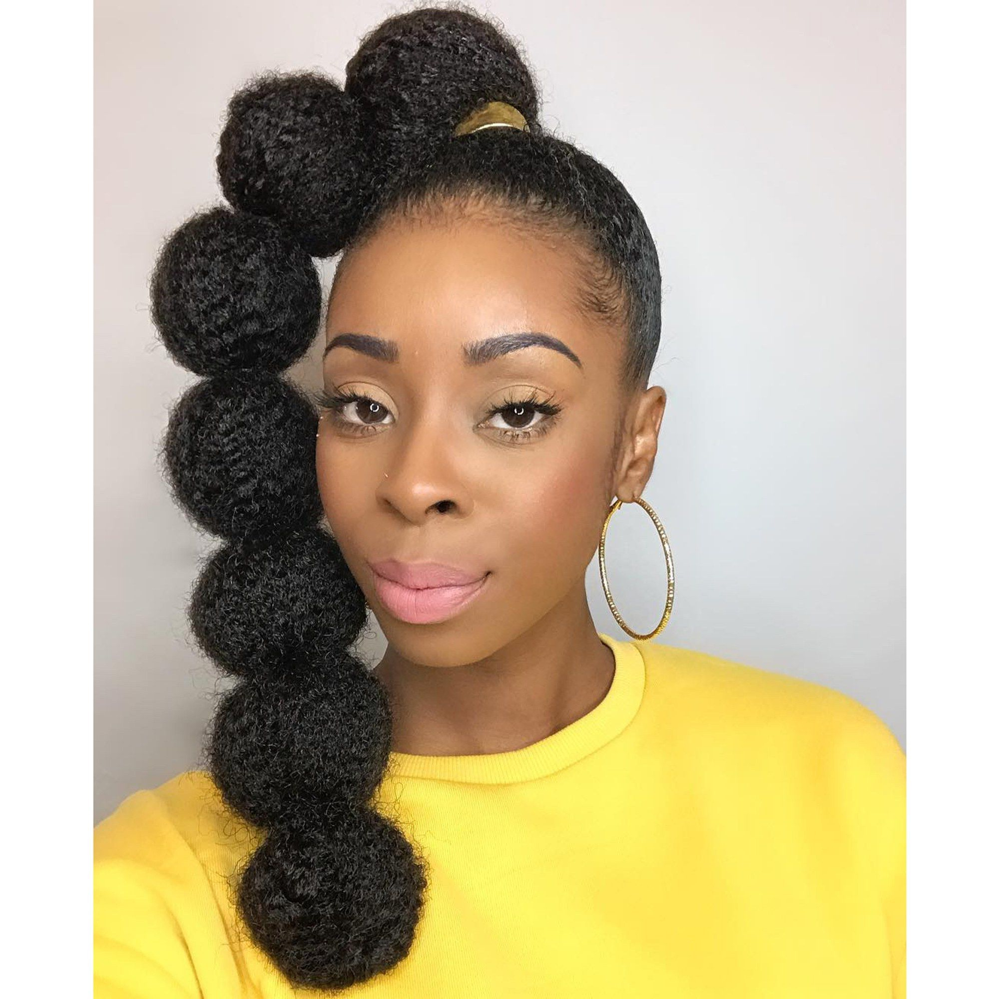 Well Liked Braided Bubble Ponytail Hairstyles Pertaining To Afro Puff Bubble Ponytails Are Trending On Instagram (View 9 of 20)