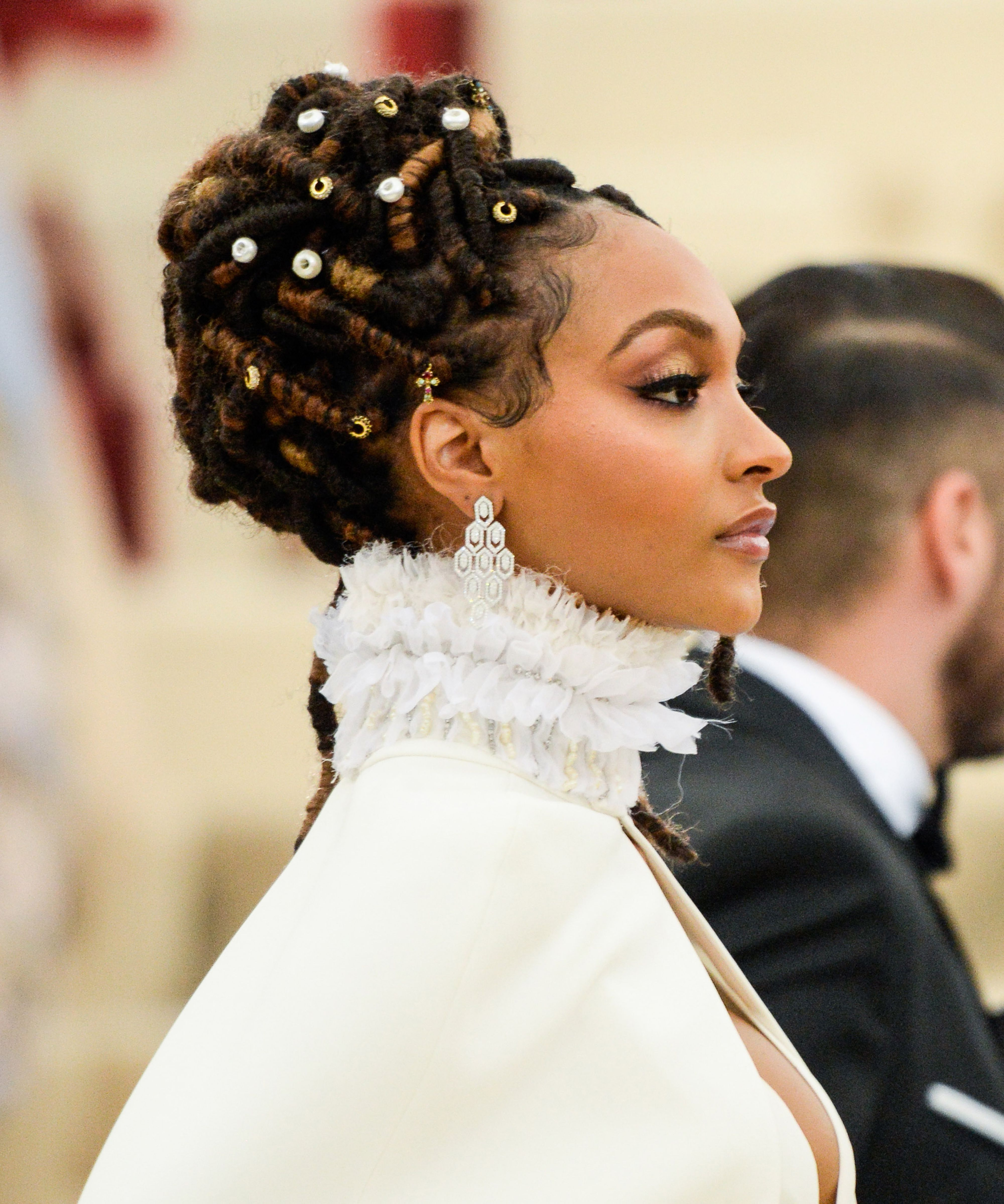 2019 Blinged Out Bun Updo Hairstyles Throughout Loc Updos, Braids, And Twists For Wedding Season (View 2 of 20)