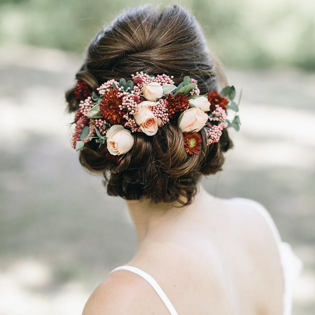 51 Romantic Wedding Hairstyles Intended For Best And Newest Floral Bun Updo Hairstyles (View 11 of 20)