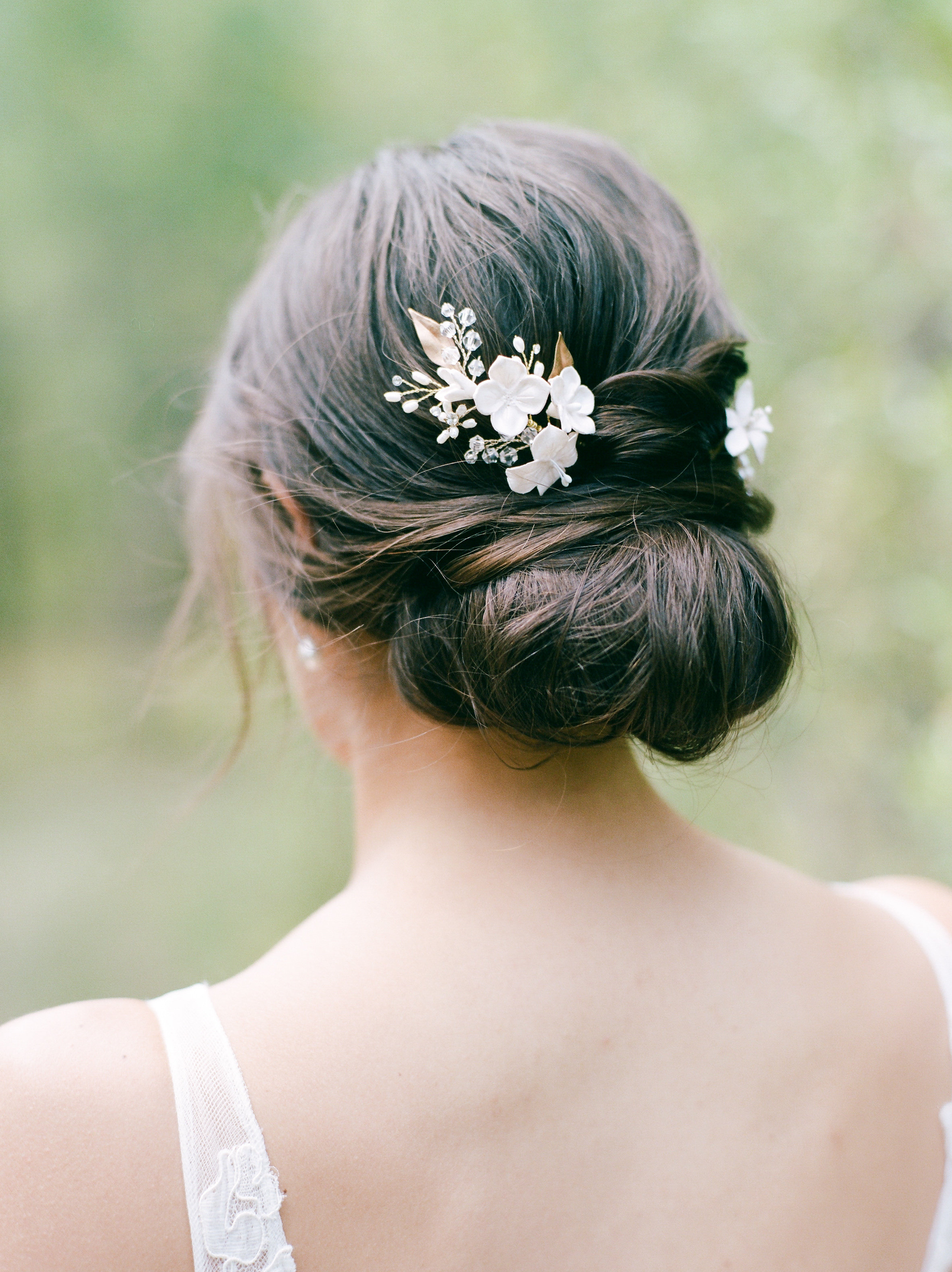 55 Simple Wedding Hairstyles That Prove Less Is More Inside Most Recently Released Floral Bun Updo Hairstyles (View 9 of 20)